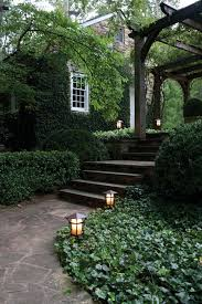 20 landscape lighting design ideas path lights pergolas and paths