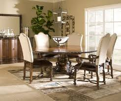 big glass window fit to upholstered dining chairs with round table