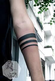 black and white geometric minimalist tribal forearm on