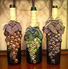 how to decorate a wine bottle for a gift wine bottles decorated with glass marble grapes glued to the