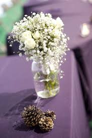 baby s breath bouquets pinecones next to white baby s breath bouquet weddingday
