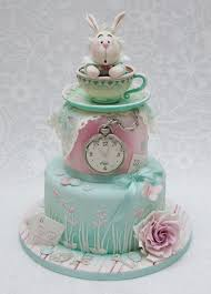 splendid alice in wonderland white rabbit teacup cake between