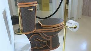 golden toilet covered in louis vuitton bags on sale for 100 000