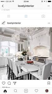 White On White Kitchen Ideas Lovely Decorative Range Hood With Detailed Columns Flanking The