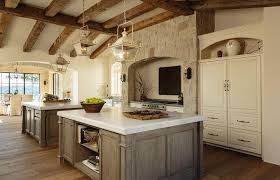 distressed kitchen islands mediterranean kitchen with rustic wood ceiling beams