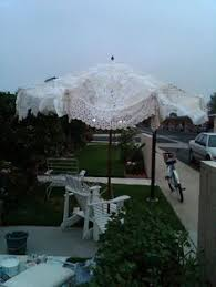 take the canvas cover off of a patio umbrella then sew together 3