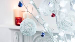 string baubles hanging on white branches diy christmas string