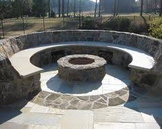 Backyard Firepit Ideas by Love The Outdoor Fire Pit With The Stone Sitting Bench Favorite
