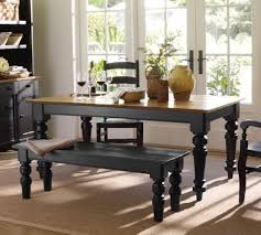 painted farmhouse table with black color paired with bench and