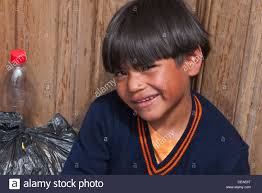 haircut for 5 year old boys a 4 5 year old hispanic boy smiles as he faces forward and leans