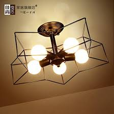 Projector Stars On Ceiling by Wormhole 6 Arm Ceiling Lamp Black Gold Brass Brothers Horne