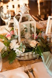 White Lantern Centerpieces by Floral And White We Heart Weddings Pinterest Lantern