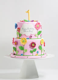 tiered happy garden cake whipped bakeshop
