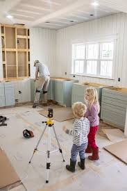 install base cabinets before flooring the burrow kitchen cabinet installation