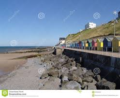 colourful houses on the beach in a small english town uk stock