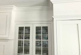 how to make cabinets appear taller how to fill space between cabinets and ceiling caroline on