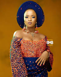 african make and asooke hair styles trendy and unique coral beaded aso oke for the bride who wants to