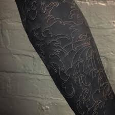 55 uncommon black tattoo ideas against all the odds