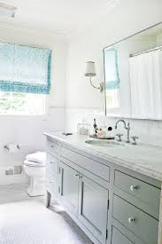 Mosaic Bathroom Floor Tile by Bathroom With Light Blue Roman Shades Marble Counters Hexagon