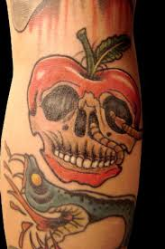 skull face apple tattoo with snake tattoos book