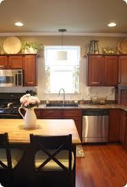 above kitchen cabinet decor ideas decorate above kitchen cabinets kitchen cabinet decorations