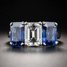 three stone engagement rings 1 73 carat emerald cut diamond and no heat sapphire three stone