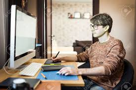 young man at home using a computer freelance developer or