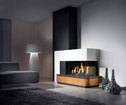 brown wooden fireplace base connected by black metal fire box and