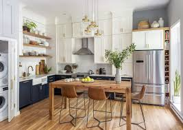 two tone kitchen cabinets and island two tone cabinets and an open wood island in a kitchen