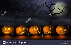 frightening halloween pumpkins or jack o u0027lanterns in a spooky and
