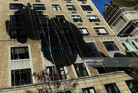 the shadow of the diary of a wimpy kid balloon falls on a building
