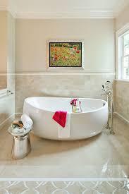 bathroom beige bathroom with metal towel stool also freestanding