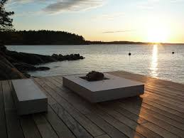Floating Fire Pit by Overby Summer House Features Infinity Pool Boat Pier And 2 Fire Pits