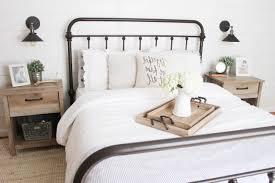 farmhouse style bedroom white fabric decorative pillow blanket