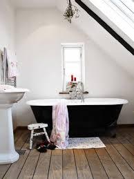 Hardwood Floors In Bathroom Black Clawfoot Tub Placed In The Bathroom With Hardwood Floors
