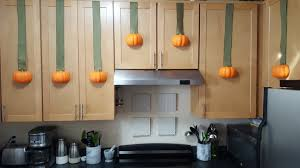 fall or halloween decorations for kitchen cabinets pumpkin ribbon