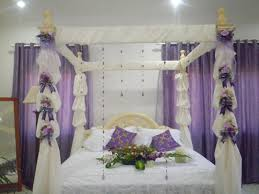 wedding bedroom decoration with flowers and candles beautiful