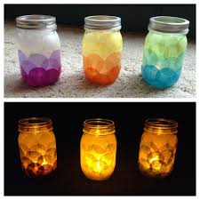 diy candle holders tissue paper glued with modge podge onto a