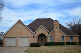 exterior paint options for house with brown roof exterior