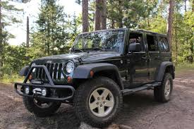 2011 Wrangler File 2011 Jeep Wrangler Propped On Wood Stacks Jpg Wikimedia Commons