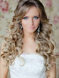 beach wedding messy hairstyles with flower for long hair