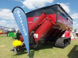 the 2 000 bushel red elmers tracked haul master grain cart this