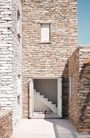 split houses cometa architects builds rocksplit house into the greek island