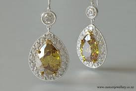 diamond earrings nz pear cut fancy yellow diamond halo earrings new zealand