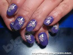 purple gel nails with pink flowers nails by rabbit