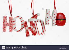 festive ho ho ho hanging candy christmas tree ornaments on a white