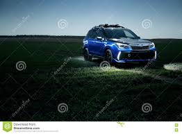 car subaru forester stand at countryside off road on green field