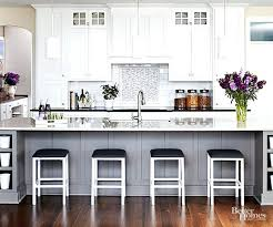 Black Appliances Kitchen Design - pictures of kitchens with white cabinets and dark floors the