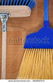 closeup dustpan sweeping broom on wooden stock photo 660692461