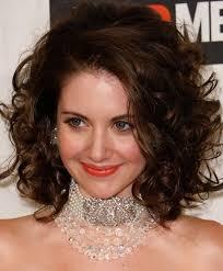 puffy woman curly hair 20 medium layered haircuts